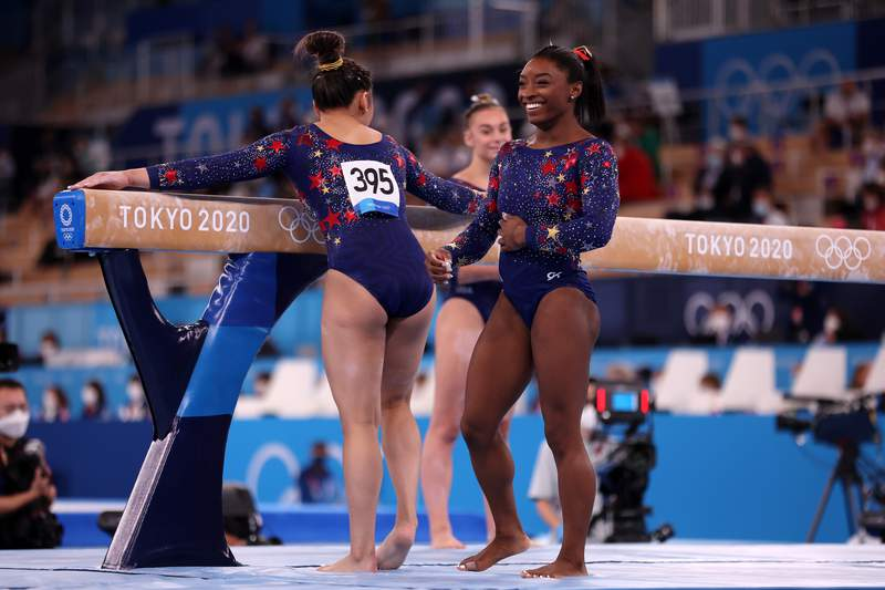 TOKYO, JAPAN - JULY 25: Sunisa Lee and Simone Biles of Team United States react during Women's Qualification on day two of the Tokyo 2020 Olympic Games at Ariake Gymnastics Centre on July 25, 2021 in Tokyo, Japan. (Photo by Jamie Squire/Getty Images)