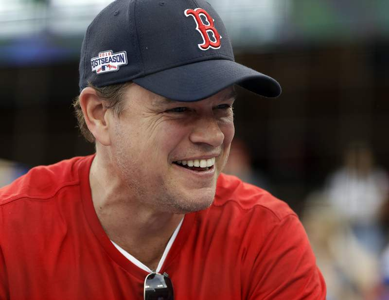 FILE - In this Sunday, Oct. 28, 2018 file photo, Actor Matt Damon waits for Game 5 of the World Series baseball game in Los Angeles. Damon has on Wednesday, May 13, 2020 described living in Ireland during the countrys coronavirus lockdown as like being in a fairy tale during a surprise radio interview. The Hollywood star and his family were in Dublin, where he had been filming Ridley Scotts The Last Duel, before travel restrictions were imposed worldwide. (AP Photo/David J. Phillip, file)