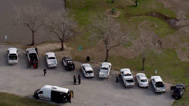 Homicide detectives are investigating after a body was found inside a van at George Bush Park on Jan. 10, 2019.