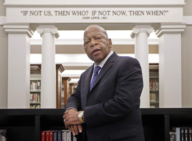 FILE - This Nov. 18, 2016 file photo shows Rep. John Lewis, D-Ga., in the Civil Rights Room in the Nashville Public Library in Nashville, Tenn. The award-winning graphic novels about the congressmen and civil rights activist John Lewis will continue a year after his death. Abrams announced Tuesday that Run: Book One will be published Aug. 3, just over a year after Lewis died at age 80. (AP Photo/Mark Humphrey, File)