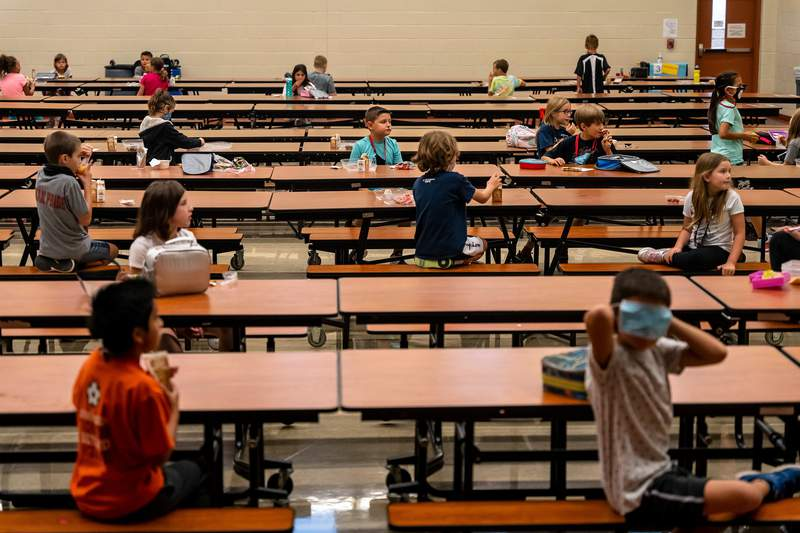 Students sit at socially-distanced intervals in the lunch room at Jacobs Well Elementary School in Wimberley on Sept. 4, 2020.