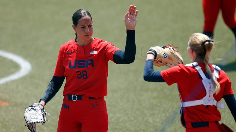 United States pitcher Cat Osterman celebrates with catcher Aubree Munro against Italy in an opening round softball game during the Tokyo Olympic Games at Fukushima Azuma Stadium.