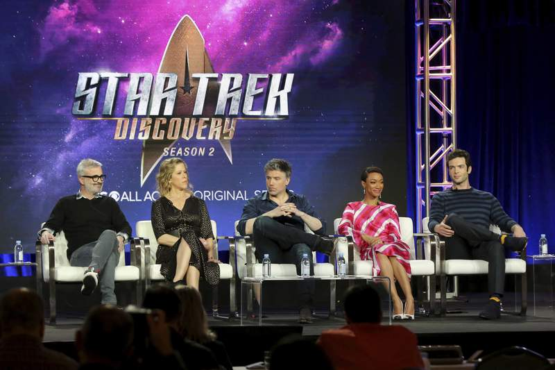 """FILE - In this Jan. 30, 2019 file photo, Alex Kurtzman, from left, Heather Kadin, Anson Mount, Sonequa Martin-Green and Ethan Peck participate in the """"Star Trek: Discovery"""" show panel during the CBS All Access presentation at the Television Critics Association Winter Press Tour at The Langham Huntington in Pasadena, Calif. Paramount+ debuts Thursday, March 4, 2021 as the latest  and last  streaming option from a major media company, this time from ViacomCBS.  The company hopes its smorgasbord of offerings  live sports and news, reboots of its properties like Frasier and Rugrats, original shows like Star Trek: Discovery and the ViacomCBS library will entice viewers(Photo by Willy Sanjuan/Invision/AP, File)"""