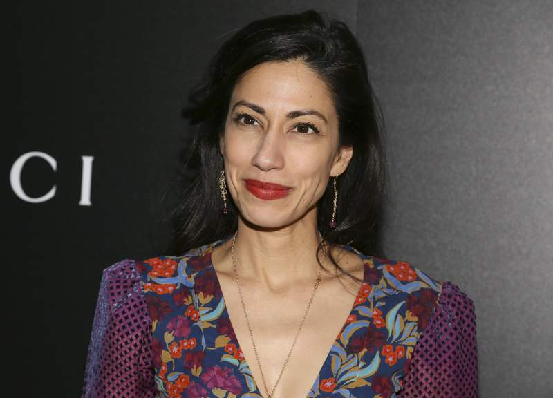 """FILE - Huma Abedin attends a screening of """"American Woman"""" on Dec. 12, 2019, in New York. Abedin has a memoir coming out this fall. The close aide to Hillary Clinton and estranged wife of disgraced former Rep. Anthony Weiner wrote """"Both/And: A Life in Many Worlds. Scribner told The Associated Press on Thursday that the book will be released Nov. 2. (Photo by Andy Kropa/Invision/AP, File)"""