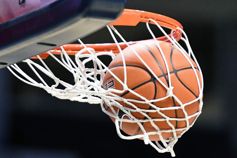 CINCINNATI, OH - FEBRUARY 13:  Detail view as a basketball goes through the hoop during a college basketball game between the Xavier Musketeers and the Connecticut Huskies at Cintas Center on February 13, 2021 in Cincinnati, Ohio.  (Photo by Mitchell Layton/Getty Images)