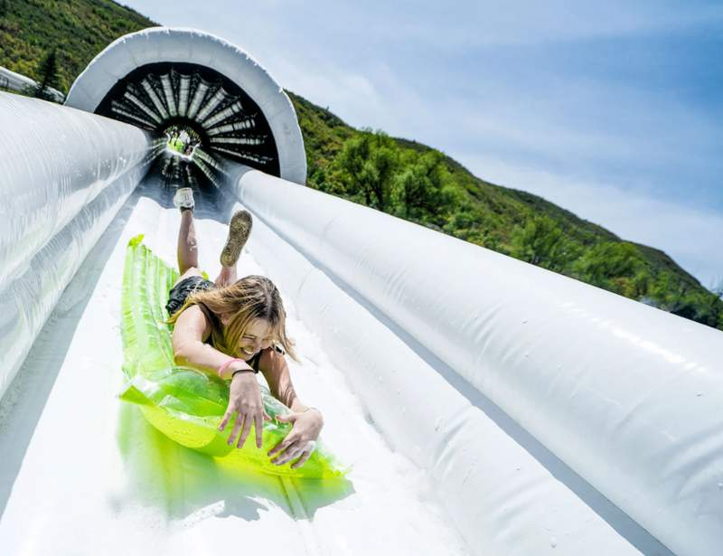 Slide The Slopes, the world's longest and biggest inflatable slip 'n' slide festival, is coming to New Braunfels, Texas.