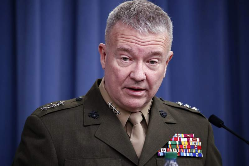 """FILE - In this April1 14, 2018, file photo, then-Marine Lt. Gen. Kenneth """"Frank"""" McKenzie speaks during a media availability at the Pentagon in Washington. The top U.S. commander for the Middle East warned Wednesday that elements of the Islamic State group are working to rebuild in western Syria, where the U.S. has little visibility or presence. In the region west of the Euphrates River where the Syrian regime is in control conditions are as bad or worse than what they were leading up to the rise of IS, said Gen. Frank McKenzie. """"We should all be concerned about that. (AP Photo/Alex Brandon, File)"""