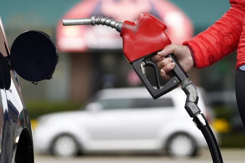 A motorist prepares to pump gas Thursday, April 22, 2021, in Portland, Maine. (AP Photo/Robert F. Bukaty)