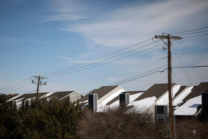 Power lines along a row of homes in South Austin. Many residents experienced power outages due to the winter storm that rolled through Texas.                    Credit: Miguel Gutierrez Jr./The Texas Tribune