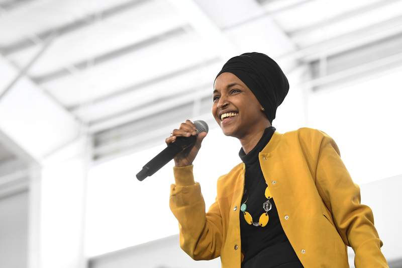 FILE - In this Feb. 29, 2020 file photo, U.S. Rep. Ilhan Omar, D-Minn., speaks at a rally in Springfield, Mass. At a young age, Rep. Omar earned a reputation as a fighter -- a bit of a misfit who saw fighting as a way to survive and earn respect. In her new memoir being released Tuesday, May, 26, 2020. Omar provides details about her life, as she went from a refugee and immigrant to congresswoman for Minnesota. (AP Photo/Susan Walsh File)