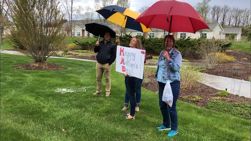 Rebecca Roy and her family serenading their grandma outside her living facility on Sunday.