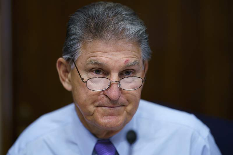 FILE - In this Aug. 5, 2021, file photo Sen. Joe Manchin, D-W.Va., prepares to chair a hearing in the Senate Energy and Natural Resources Committee, as lawmakers work to advance the $1 trillion bipartisan bill, at the Capitol in Washington. Manchin said Thursday, Sept. 2, that Congress should take a strategic pause on more spending, warning that he does not support President Joe Biden's plans for a sweeping $3.5 trillion effort to rebuild and reshape the economy. (AP Photo/J. Scott Applewhite, File)