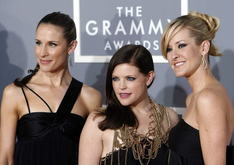 FILE - In this Feb. 11, 2007 file photo, the Dixie Chicks, Emily Robison, left, Natalie Maines, center, and Martie Maguire arrive for the 49th Annual Grammy Awards in Los Angeles. The Grammy-winning country group have dropped the word dixie from their name and are now going by The Chicks. The move follows a decision by country group Lady Antebellum to change to Lady A after acknowledging the word's association to slavery. (AP Photo/Matt Sayles, File)