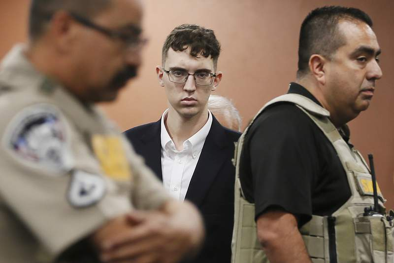 """FILE - In this Oct. 10, 2019 file photo, El Paso Walmart shooting suspect Patrick Crusius pleads not guilty during his arraignment in El Paso, Texas. Crusius attorneys said in a court filing that he has """"severe, lifelong neurological and mental disabilities. They say the 21-year-old and was treated with anti-psychotic medication following his arrest moments after the massacre in El Paso that killed 23.  (Briana Sanchez/El Paso Times via AP, Pool, File)"""