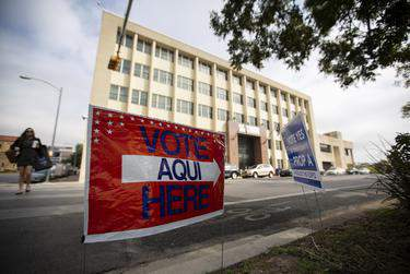 Voting signs near the Travis County Granger Building election site on Election Day, Nov. 5, 2019.      Eddie Gaspar/The Texas Tribune