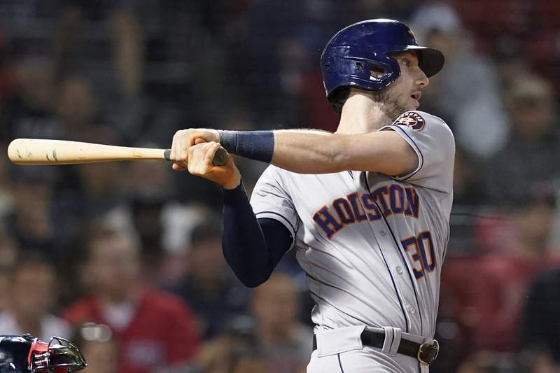 Houston Astros' Kyle Tucker follows through on a three-run double against the Boston Red Sox during the fifth inning of a baseball game at Fenway Park, Thursday, June 10, 2021, in Boston. (AP Photo/Elise Amendola)