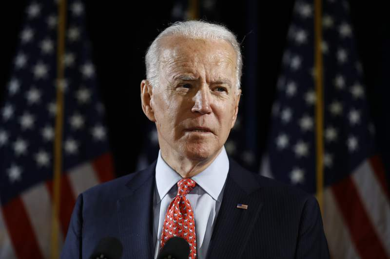 FILE - In this March 12, 2020 file photo, Democratic presidential candidate former Vice President Joe Biden speaks about the coronavirus in Wilmington, Del.  Biden overwhelmingly won a Democratic presidential primary in Kansas conducted exclusively by mail balloting by the state party because of the coronavirus pandemic. He had been expected to prevail in the vote Saturday, May 2 and capture a majority of the states delegates to the Democrats national nominating commission. Biden took 77% of the vote. (AP Photo/Matt Rourke, File)