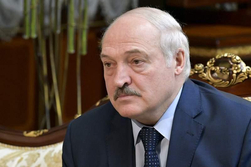 Belarusian President Alexander Lukashenko listens to Russian Prime Minister Mikhail Mishustin during their talks in Minsk, Belarus, Friday, April 16, 2021. (Alexander Astafyev, Sputnik, Kremlin Pool Photo via AP)