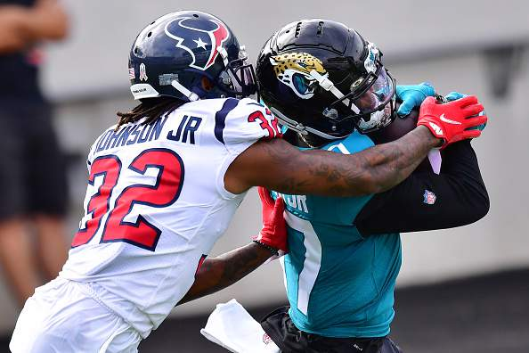 JACKSONVILLE, FLORIDA - NOVEMBER 08:  D.J. Chark #17 of the Jacksonville Jaguars scores a touchdown in front of Lonnie Johnson #32 of the Houston Texans during the first quarter of a game at TIAA Bank Field on November 08, 2020 in Jacksonville, Florida. (Photo by Julio Aguilar/Getty Images)