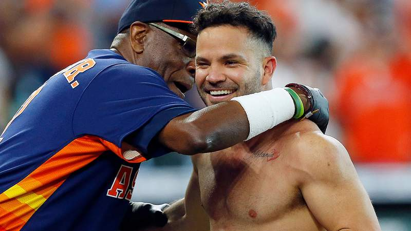 Manager Dusty Baker Jr. #12 of the Houston Astros hugs Jose Altuve after hitting a three run walk off home run in the ninth inning to beat the New York Yankees 8-7 at Minute Maid Park on July 11, 2021 in Houston.