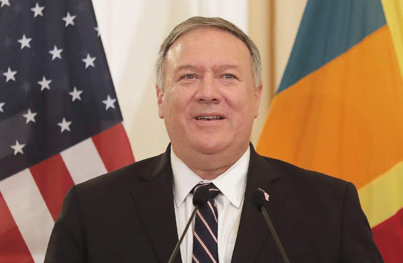 U.S. Secretary of State Mike Pompeo speaks during a joint press briefing with Sri Lankan Foreign Minister Dinesh Gunawardena in Colombo, Sri Lanka, Wednesday, Oct. 28, 2020. In pre-recorded remarks Wednesday to a business conference taking place in Vietnam, Pompeo says the U.S. energy firm AES and PetroVietnam plan to soon sign an agreement on a $2.8 billion liquefied natural gas project. (AP Photo/Eranga Jayawardena)