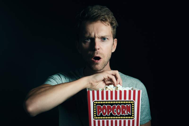 Generic image of a man watching scary movies