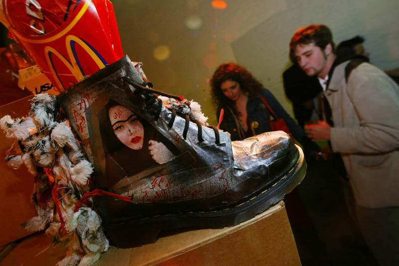 FILE - In this Wednesday, April 23, 2003 file photo, a pair of Dr. Martens 1460 workboots, as interpreted by designers Michael & Hushi, are part of an exhibition of Dr. Martens boots in New York. The Dr. Martens footwear company is set to list on the London Stock Exchange for the first time next week. Shares in the company which pioneered the air-cushioned sole, will go on public sale on Wednesday Feb. 3, 2021, in a flotation that values the shoe brand at around 3.7 billion pounds ($5 billion). (AP Photo/Joe Kohen, file)