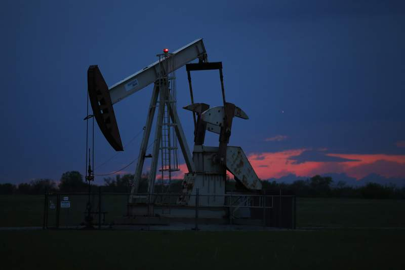 FILE In this April 21, 2020 file photo, a pumpjack is pictured as the sun sets in Oklahoma City.  Google says it wont build custom artificial intelligence tools for speeding up oil and gas extraction, taking an environmental stance that distinguishes it from cloud computing rivals Microsoft and Amazon.  The announcement followed a Greenpeace report on Tuesday, May 19,  that documents how the three tech giants are using AI and computing power to help oil companies find and access oil and gas deposits in the U.S. and around the world. (AP Photo/Sue Ogrocki File)
