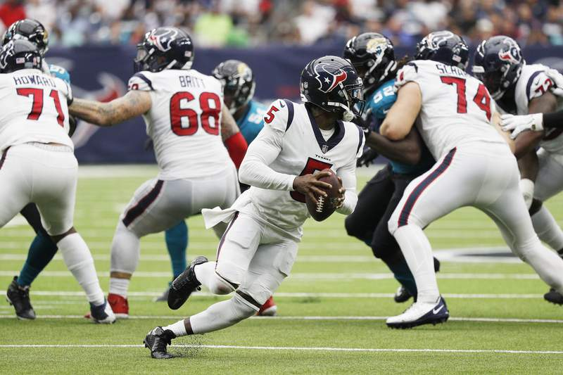 """Houston Texans quarterback Tyrod Taylor rolling to the right during a game. """"pictured here"""""""