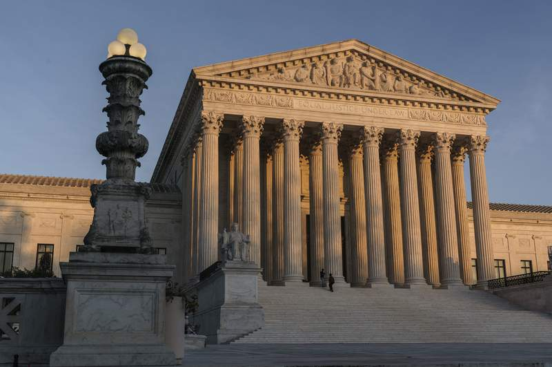FILE - In this Nov. 6, 2020, file photo the Supreme Court is seen as sundown in Washington. The Supreme Court says it will not hear a case out of Pennsylvania related to the 2020 election, a case that had lingered while similar election challenges had already been rejected by the justices. The high court directed a lower court to dismiss the case as moot. (AP Photo/J. Scott Applewhite, File)