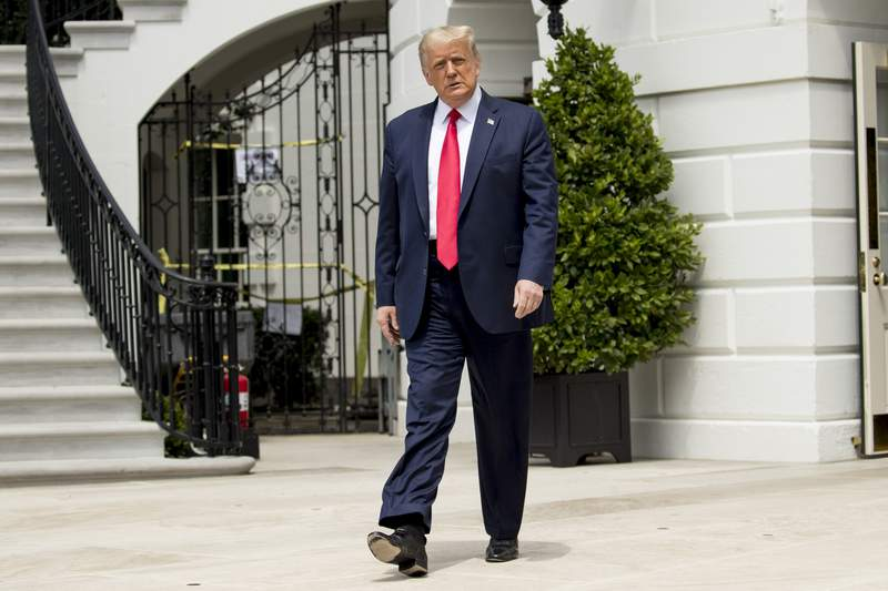 President Donald Trump walks towards members of the media before boarding Marine One on the South Lawn of the White House in Washington, Thursday, Aug. 6, 2020, for a short trip to Andrews Air Force Base, Md. and then on to Cleveland, Ohio. (AP Photo/Andrew Harnik)