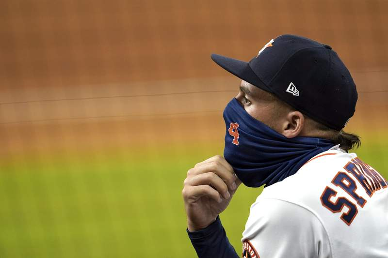 FILE PHOTO - Houston Astros' George Springer watches from the dugout during the fifth inning of a baseball game against the Los Angeles Dodgers Wednesday, July 29, 2020, in Houston. (AP Photo/David J. Phillip)