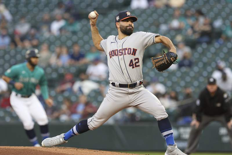 Houston Astros starting pitcher Jose Urquidy throws to a Seattle Mariners batter during the second inning of a baseball game Friday, April 16, 2021, in Seattle (AP Photo/Jason Redmond)