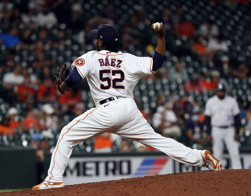 HOUSTON, TEXAS - AUGUST 10: Pedro Baez #52 of the Houston Astros pitches in the ninth inning against the Colorado Rockies at Minute Maid Park on August 10, 2021 in Houston, Texas. (Photo by Bob Levey/Getty Images)
