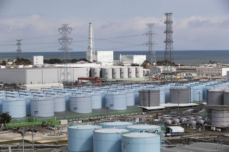 FILE - In this Saturday, Feb. 27, 2021, file photo, Nuclear reactors of No. 5, center left, and 6 look over tanks storing water that was treated but still radioactive, at the Fukushima Daiichi nuclear power plant in Okuma town, Fukushima prefecture, northeastern Japan. (AP Photo/Hiro Komae, file)