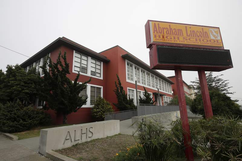 """FILE - This March 12, 2020, file photo, shows the Abraham Lincoln High School in San Francisco. The number of suicidal children in San Francisco has hit a record high and health experts say it is clear that keeping public schools closed """"is catalyzing a mental health crisis among school-aged children,"""" according to a lawsuit the city filed Thursday, Feb. 11, 2021, to push its school district to reopen classrooms. (AP Photo/Jeff Chiu, File)"""