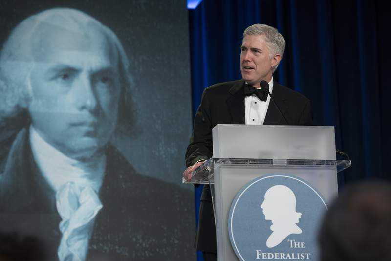 FILE - In this Nov. 16, 2017, file photo, Supreme Court Associate Justice Neil Gorsuch speaks at the Federalist Society's 2017 National Lawyers Convention in Washington. A liberal activist group is launching a digital ad campaign targeting the Federalist Society, a conservative legal organization that has championed judges appointed by President Donald Trump, including Supreme Court Justices Brett Kavanaugh and Gorsuch. The ads, to appear on LinkedIn and Facebook, target major law firms that were sponsored the Federalist Societys annual dinner.  (AP Photo/Sait Serkan Gurbuz, File)