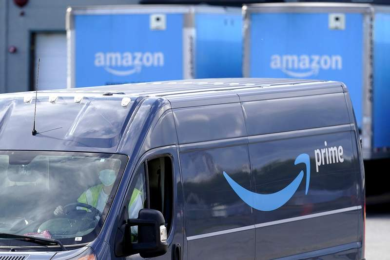 An Amazon Prime logo appears on the side of a delivery van as it departs an Amazon Warehouse location, Thursday, Oct. 1, 2020, in Dedham, Mass. Halloween is still weeks away, but retailers are hoping youll start your holiday shopping now. The big push is coming from Amazon, which is holding its annual Prime Day sales event Tuesday, Oct. 13 and Wednesday, Oct. 14.  (AP Photo/Steven Senne)