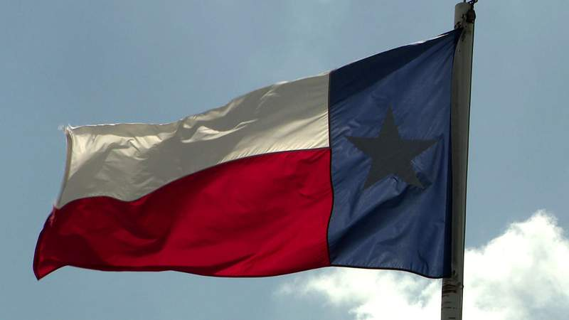 The flag of the state of Texas flaps in the wind in Rosenberg, Texas, in this undated file image.