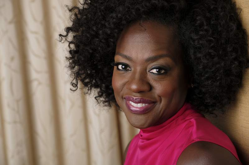 FILE - In this Sept. 9, 2018, file photo, Viola Davis poses for a portrait at the Ritz-Carlton Hotel during the Toronto International Film Festival in Toronto. The new issue of Vanity Fair, featuring a powerful image of Oscar-winning actor Davis, marks the first time the publication has featured the work of a Black photographer on its cover. The issue hits newsstands on July 21, 2020. (Photo by Chris Pizzello/Invision/AP, File)