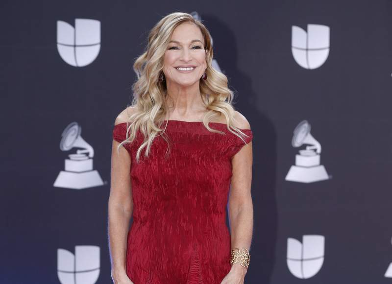 FILE - This Nov. 14, 2019 file photo shows Grammys CEO Deborah Dugan at the 20th Latin Grammy Awards in Las Vegas. Dugan has fired back at the Recording Academy with a complaint claiming she was retaliated against after reporting she was subjected to sexual harassment and gender discrimination during her six-month tenure. Lawyers for Dugan, who the academy placed on administrative leave last week, filed a discrimination case with the Equal Employment Opportunity Commission on Tuesday. In the complaint, she claims she was subjected to sexual harassment from the academys general counsel. (Photo by Eric Jamison/Invision/AP, File)