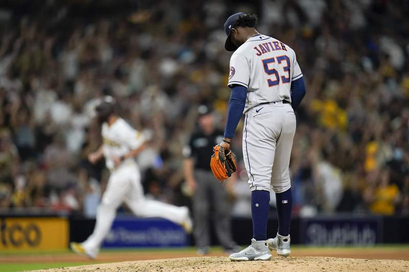 Houston Astros relief pitcher Cristian Javier (53) stands on the mound as San Diego Padres' Wil Myers rounds the bases after hitting a two-run home run during the seventh inning of a baseball game Saturday, Sept. 4, 2021, in San Diego. (AP Photo/Gregory Bull)