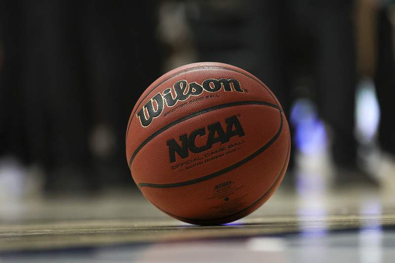 BLOOMINGTON, INDIANA - MARCH 20: Detail shot of the NCAA official game ball during the game between the Ohio Bobcats and the Virginia Cavaliers in the first round of the 2021 NCAA Men's Basketball Tournament at Assembly Hall on March 20, 2021 in Bloomington, Indiana. (Photo by Stacy Revere/Getty Images)