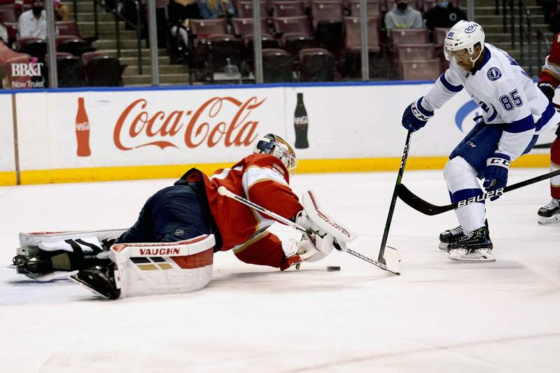 Florida Panthers goaltender Chris Driedger, left, defends the goal against Tampa Bay Lightning's Daniel Walcott (85) during the first period of an NHL hockey game, Monday, May 10, 2021, in Sunrise, Fla. (AP Photo/Lynne Sladky)