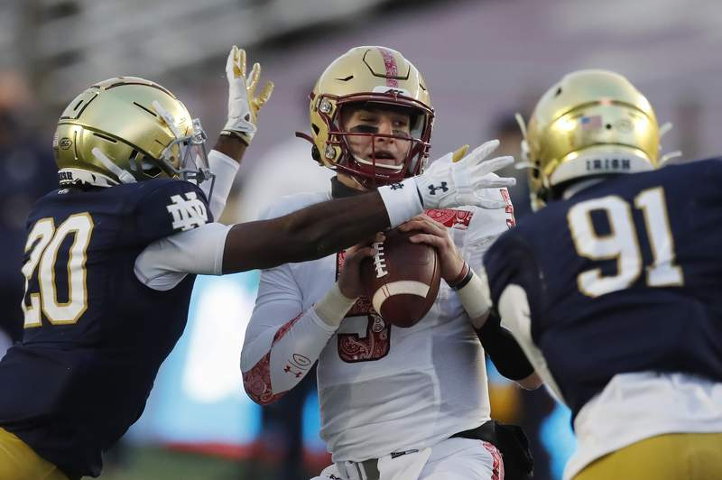 Notre Dame safety Shaun Crawford (20) sacks Boston College quarterback Phil Jurkovec (5) during the first half of an NCAA college football game, Saturday, Nov. 14, 2020, in Boston. (AP Photo/Michael Dwyer)