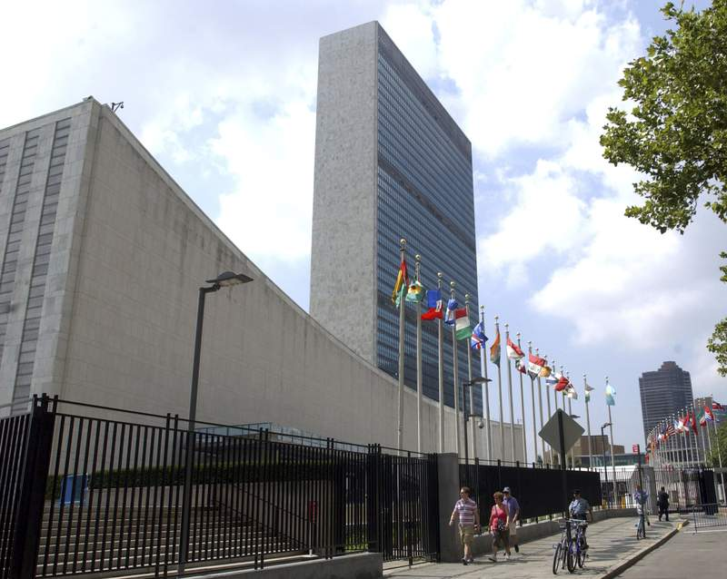 FILE - This July 27, 2007 file photo shows the United Nations Headquarters building in New York.  Two Myanmar citizens have been arrested on charges alleging that they conspired to oust Myanmar's ambassador to the United Nations by injuring or killing him. U.S. Attorney Audrey Strauss said in a release on Friday, Aug. 6, 2021 that Phyo Hein Htut and Ye Hein Zaw plotted to seriously injure or kill Kyaw Moe Tun in an attack that was to take place in Westchester County. (AP Photo/Osamu Honda, File)