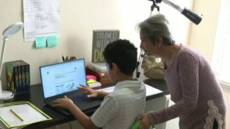 Family members help with virtual learning during pandemic