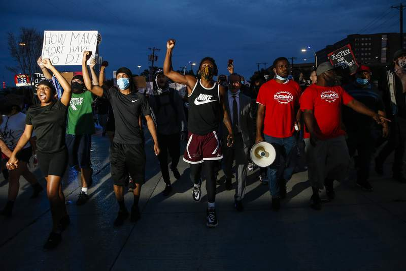 FILE PHOTO In this June 1, 2020, photo, protesters march to the Margaret Hunt Hill Bridge as they demonstrate against police brutality in Dallas. Protests continue over the death of George Floyd, a black man who died after being restrained by Minneapolis police officers on May 25. (Ryan Michalesko/The Dallas Morning News via AP)