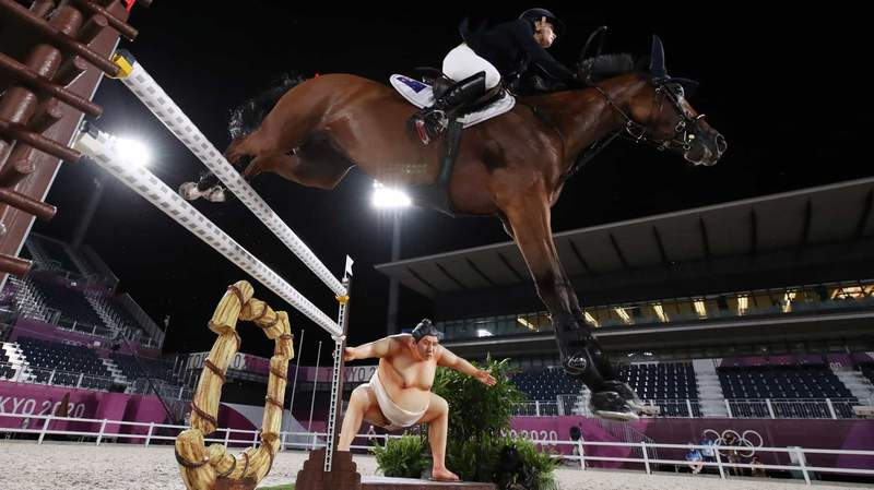 Some horses have been spooked by the sumo display at the 10th jump on the Olympic show jumping course in Tokyo.