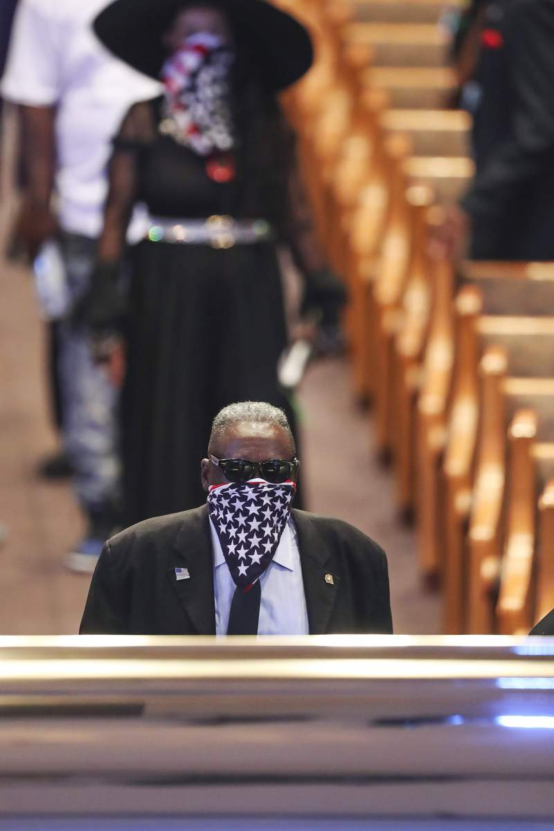 A mourner views the casket of George Floyd during a public visitation Monday, June 8, 2020, at The Fountain of Praise church in Houston. (Godofredo A. Vsquez/Houston Chronicle via AP, Pool)